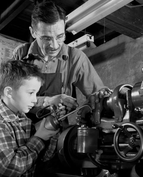 Father And Son Working On Machinery